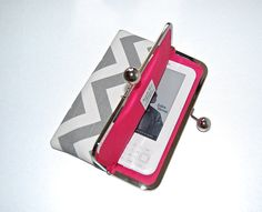 "Unique iPad mini and eReader / Kindle / Sony / Nook Clutch Case ""Chevron Ash Gray"". $44.00, via Etsy."