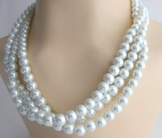 Multi strand white glass pearls necklace. Perfect for brides or bridesmaid, or any other special occasion! This necklace definitely has a wow factor!! White pearl three strand necklace 8mm twisted around each other Wedding Jewelry Set, Bridal Jewelry Set, Bridesmaid Necklace absolutely gorgeous & rich complimentary color. Customize Pearl Jewelry and other colors are available to purchase Material : Glass pearls Ivory 8mm 10mm Color : White Necklace Length : 18 Inches with 2 1/2 inches…