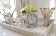 Store office supplies in style with a simple, white tray.