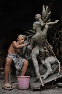 This business owner in Calcutta uses loan capital to create statues for Durga Puja.----pretty awesome