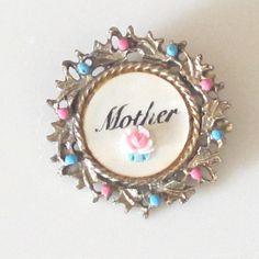 Darling Vintage Mother of Pearl  'Mother' Brooch. https://www.pinterest.com/rubylanecom/vintage-jewelry-under-25/