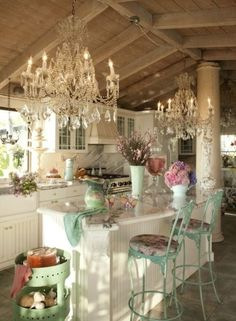 love the mint chairs on white. Love the high ceiling s and exposed wood. Chadeliers make it look fancy fresh.
