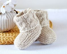 KNITTING PATTERN Baby Booties with Aran Cable Cuffs - This listing is for a PATTERN and not the finished item. Baby Booties in Classic traditional Aran Pattern - Double turn-down cuffs for comfort, luxury and security - difficult to kick off! Baby Knitting Patterns, Pattern Baby, Baby Booties Knitting Pattern, Knitting Terms, Knit Baby Booties, Knitting Stitches, Free Knitting, Knitting Projects, Crochet Patterns