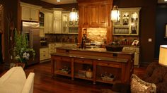 Inspiration kitchen from Extreme Makeover, Mattingly Family - Square raised panel Kraftmaid in Praline and Willow Finishes.  Love the rustic elegance of it.