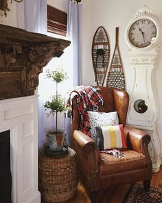 love this little corner, fabulous leather chair, snow shoes, etc