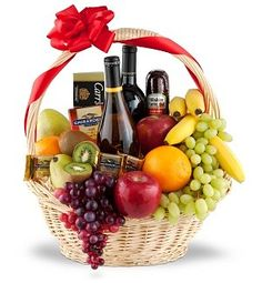 The Premium Selection Fruit Wine Gift Basket. Our premium basket is delivered brim-full with delightfully fresh fruit, flavorful sausages, as well as a selection of cheeses and crackers. We also tuck in a sweet chocolate treat to round out the selection. Themed Gift Baskets, Wine Gift Baskets, Basket Gift, Fruit Gift Baskets, Fruit Basket Delivery, Fruit Hampers, Cadeau Parents, Fruit Gifts, Diy Holiday Gifts