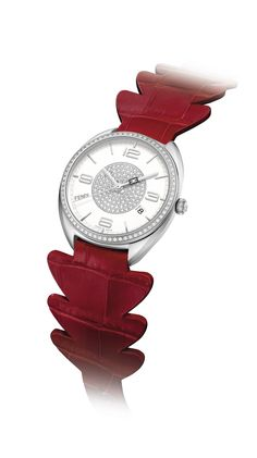 The Momento Fendi Limited Edition ladies watch is a statement of romance with its sleek steel case, shimmering diamonds and superb red strap in the shape of an alligator tail.