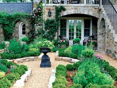 Design Chic - love a gravel courtyard  love everything about it.  the Gravel, pathways, house, patio.  Amazing....