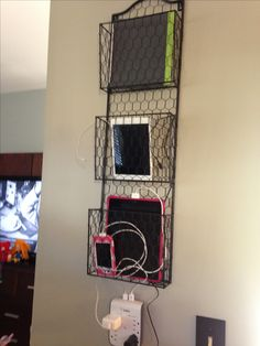 We have numerous devices between tablets and phones in my house.  I've been trying to figure out a way to charge them but keep them off the counter.  And then it hit me.  Picked up this letter/file holder from Home Goods for $19.99.  It is secure to the wall with heavy duty screws/anchors so it won't come crashing down.  - Chord organization - iPad iPhone charger
