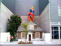 """""""In the Ballard neighborhood of Seattle, there's a huge shopping mall with a strange hole in the center of the building. Inside that gap sits a tiny house with an amazing story that some say inspired Pixar's UP."""" » What a sweet story this is!"""