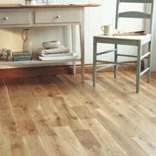 light wood laminate floor basement . Beachy look