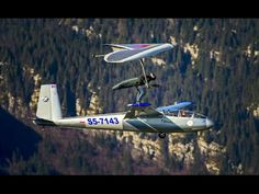 ▶ Hang Glider Touches Down on Sail Plane