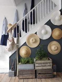 Required Reading: Living Beautifully by Cabbages and Roses founder Christna Strutt, Photograph by Simon Brown, hats hanging in hallway, shabby chic | Remodelista