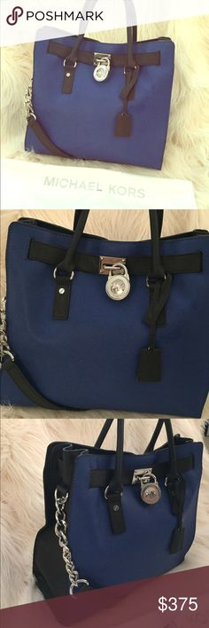 Michael Kors Large Hamilton Bag Michael Kors Large Hamilton tote with blue and black contrasting colors. Short handles for easy functionality or a long shoulder strap to carry like a tote bag. No signs of wear, fantastic condition. Comes with a duster bag, has been sitting in my closet for two years! Michael Kors Bags Totes