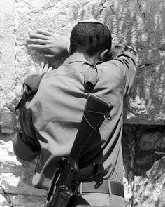 Street Photography: Israel. Soldier praying at Kotel