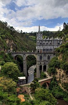 """The Santuario de Las Lajas is a place of worship and pilgrimage situated in the canyon of the river formed Guaitara . It is located in the municipality of Ipiales , department of Nariño in southern Colombia .0 ° 48'19 .00 """"N 77 ° 35'09 .00"""" O"""