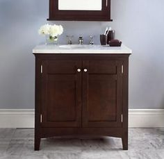 Dark vanity for my bathroom -- coordinating wood stain on medicine cabinet.