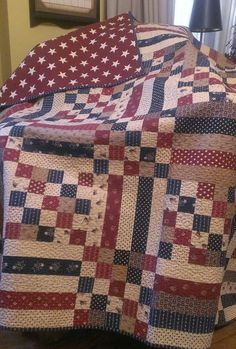 """Primitive Gatherings """"Picnic Quilt"""" design made with a collection of Americana fabrics."""