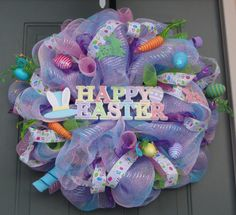"""""""Like"""" EverWreath on Facebook for sneak peeks and promos! http://www.facebook.com/everwreath  Happy Easter! This Happy Easter wreath will make a beautiful addition to your Easter and Spring decor! It is really pretty and colorful and is very full at 28"""" across. This wreath is made with pink and blue striped poly mesh, RAZ Easter egg spray and 24"""" work wreath all purchased from http://www.trendytree.com"""