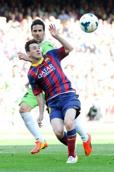 Lionel Messi of FC Barcelona competes for the ball with Juan Rodriguez of Getafe CF during the La Liga match between FC Barcelona and Getafe CF at Nou Camp on May 3, 2014 in Barcelona, Catalonia.