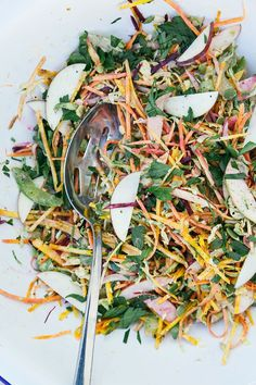 shredded brussels sprouts + fall vegetable salad w/ garlicky orange tahini dressing - The First Mess