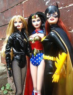 Black Canary, Wonder Woman, and Batgirl Barbies