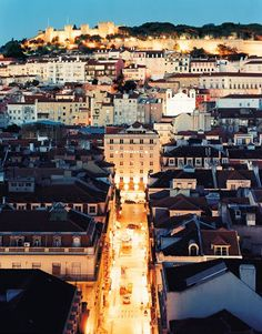 The Alfama district in Lisbon, Portugal, was miraculously spared by the 1755 earthquake. Both old Moorish and low-rise modern architecture slope toward the crenellated Castelo de São Jorge