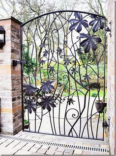 Whimsical Garden Gate - Wrought iron with sculpted flowers.