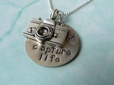 I wants!  Capture Life / Camera charm Necklace / Personalized by you. $24.50, via Etsy.