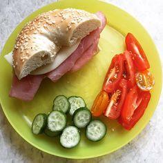 Yum fresh bagel day! Sesame bagels from our favorite local shop, nitrate free honey ham, smoke Provelone (that was rejected today but gotta keep trying). Sides of multicolored tomatoes and baby cucumbers. #yum #yummy #kidfood #kidlunch #preschoollunch #toddlerfood #toddlerfoodideas #onmykidsplate #momlife