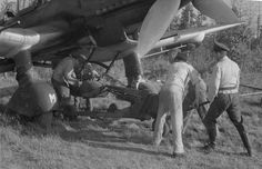 Photo: Suspension of bombs on German bomber Ju-87 at the airfield Immola