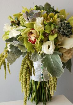 green succulent and orchid wedding flower bouquet, bridal bouquet, wedding flowers, add pic source on comment and we will update it. www.myfloweraffair.com can create this beautiful wedding flower look.