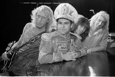 British pop star Elton John, second from left, is seen at the rehearsal studios at Millwall in London's Dockland, Oct. 31, 1982, with original members of his band.  John and the band are slated to tour the U.K. for the first time in over five years.  From left to right:  Davey Johnston, guitar; John; Nigel Olsson, drums; and Dave Murray, bass.  / Credit: AP Photo/Joe Schaber