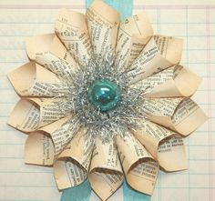 paper pages and blue wreath