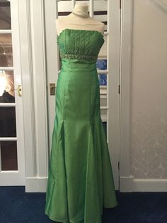 Bright green strapless mermaid with beading. perfect if you are a petite size 6