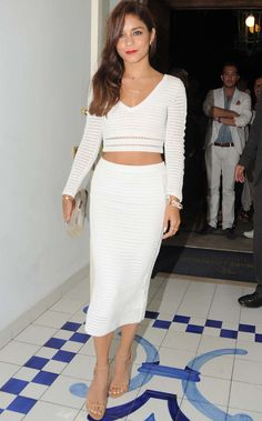 Vanessa Hudgens in total white look with cropped top. Elegant