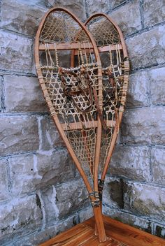 """These antique snowshoes originated at """"River Ridge Camp"""" and have no doubt traveled many miles through deep winter snows in the Cold River Region of the central Adirondack Mountains. These vintage, """"old school"""" snowshoes are in good condition. They make for a great conversation piece or a wall hanging in your cabin or in a lodge-themed family or game room at home. Buy them here: Campfitters.com"""