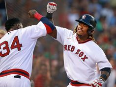 07/20/16: Boston, MA: Red Sox DH David Ortiz (left) greets teammate Hanley Ramirez as he heads into the dugout following his third inning home run, his second round tripper in as many innings. The Boston Red Sox hosted the San Francisco Giants in an inter league MLB baseball game at Fenway Park. (Globe Staff Photo/Jim Davis) section:sports topic: Red Sox-Giants