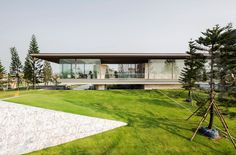 office at floats transparent box over stone formations for the grand pinklao  clubhouse in bangkok