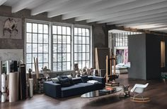 "Built in 1926 and located close to Lake Como, in northern Italy. This gorgeous 270 square meters loft was kept in its original form and holds many of its owner own artwork. Architect and artist Marco Vido has been content with small steps to make it into his dream apartment. Brick walls and windows are untouched, while the concrete floor has got natural parquet in ""vulcano oak"" from the Austrian manufacturer Mafi."