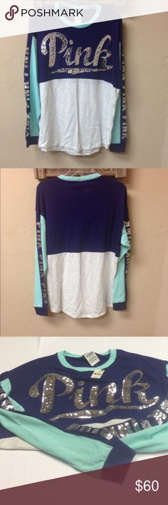Victoria's Secret PINK Crew Neck Bling Tee Authentic new with tag Victoria's Secret Tee. Color: violet blue, aqua and gray. It has silver sequin logo on the front and all over the sleeves. It is an oversized Medium. Smoke Free and Pet Free Environment. PINK Victoria's Secret Tops Tees - Long Sleeve