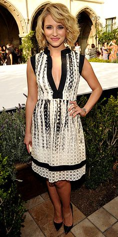 DIANNA AGRON in a flirty, full-skirted black-and-white frock with a plunging neckline
