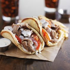 greek gyros with tzatziki sauce and fries on parchment, shot with selective focus Lamb Recipes, Greek Recipes, Wine Recipes, Food Trucks, Lamb Gyro Recipe, Sauce Tzatziki, Lamb Gyros, Gyro Meat, Greek Gyros