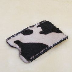 This case is a hair on hide made to fit the 4 or 4S I Phone. $12