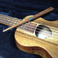 A pair of chopsticks made of Hawaiian koawood and my Koaloha ukulele made of Hawaiian koawood.