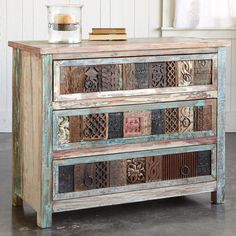 """COLLECTOR'S CHEST--Functional and fabulous, vintage carved wood blocks front this chest with three roomy drawers. Handcrafted of reclaimed wood, with random vintage paint intact. Planked top, iron pulls. Block patterns and colors will vary. Imported. 40""""W x 18""""D x 32""""H."""