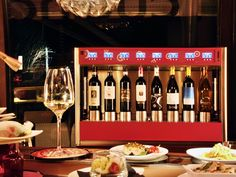 Beautiful wine dispenser in red finish from WineEmotion WineEmotion Wine Dispenser