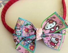 Tiara Pink Laço Hello Kitty Quadrinhos
