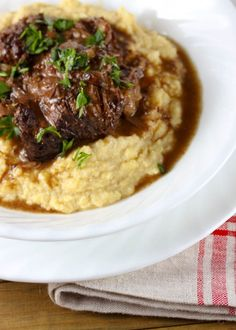 """Root Beer Braised Short Ribs - """"This can easily be my new favorite comfort food: tender short ribs in a savory and aromatic sauce over creamy polenta. It's a meat lover's dream. Seriously, insanely good short ribs. Now, be careful who you make this for. It will set the bar high, and you might get requests for more."""" from onevanillabean"""