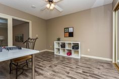 """Wood-look Laminate flooring: Zanzibar Gray from the Scottsdale Collection by Gemwoods. Wall color is Sherwin Williams """"Stone Lion""""."""